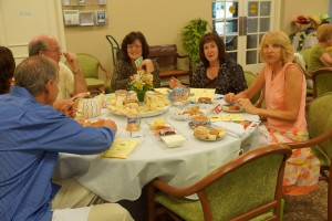Marsha Eisenberg and guests enjoy the tea and treats that were served.